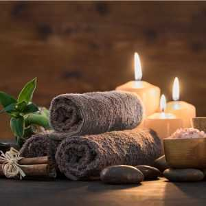 beauty-spa-treatment-with-candles-picture-id856952780