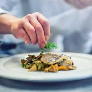 chef-in-hotel-or-restaurant-kitchen-cooking-only-hands-prepared-fish-picture-id866478564