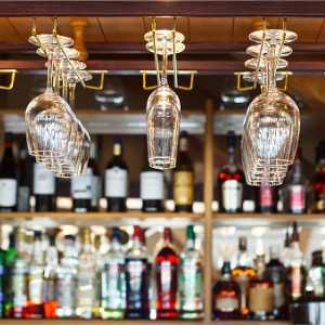 different-glasses-hanging-over-the-bar-soft-focus-picture-id586719166