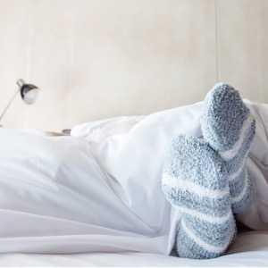 female-foot-in-warm-stripe-wool-sock-picture-id645905626