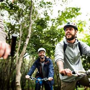 group-of-friends-ride-mountain-bike-in-the-forest-together-picture-id951396750