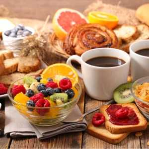 table-with-full-healthy-breakfast-picture-id1045372816