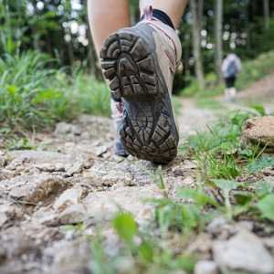 woman-walking-on-mountain-trail-picture-id1216215743